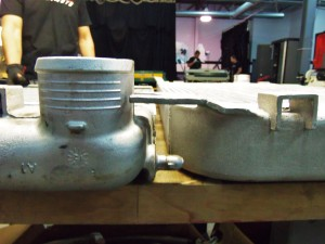 Thickness comparison of Mishimoto prototype intercooler (right) and factory intercooler (left)