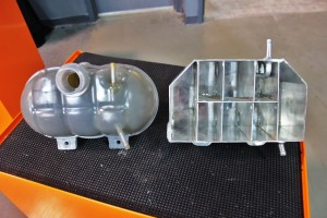 Stock expansion tank (left) and Mishimoto expansion tank prototype (right)