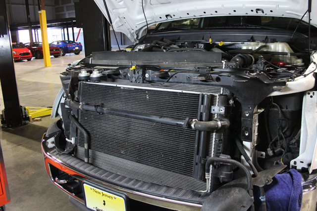The front of the 6.7L; The Secondary radiator is front and center, behind the AC Condenser